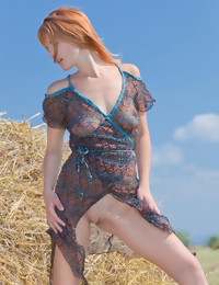  Violla basks in the sunlight on a field of hays with her see-through suit as she sensually poses and bares her gorgeous physique and delectable assets.